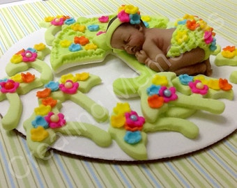 April Showers Bring May Flowers Fondant Cake and Cupcake Set baby girl or boy with flowers and umbrellas made of vanilla fondant