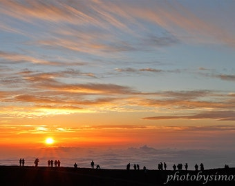 Orange sunset Haleakala Maui crater clouds people watching comet