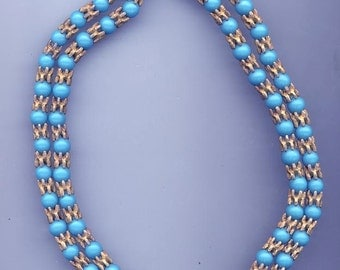 Beautiful 2-strand vintage Vogue necklace: round glass turquoise colored beads and cool matte gold tone spacers