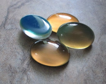 4  Cabochon,acrylic, multicolored, 25x18mm color-changing non-calibrated oval. JD238