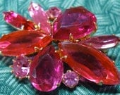 """Vintage pin, flower shaped, 3 shades of pink, claw, prong setting. 2"""" at the widest point. VFM12.2-11.4."""