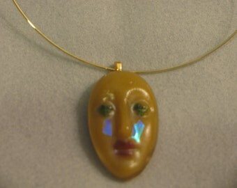 Cast glass mask necklace