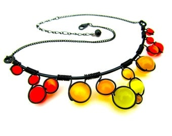 Wire wrapped necklace with bright red,  orange and yellow cat's eye beads, black wire and adjustable chain