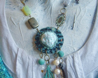 WHIMSY ANGEL PROTECTION  necklace wearable art cherub face hand carved round  pendant verdigris patina sea inspired amulet wiccan