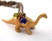 Golden dinosaur brachiosaurus bronze necklace with beads - Land before time