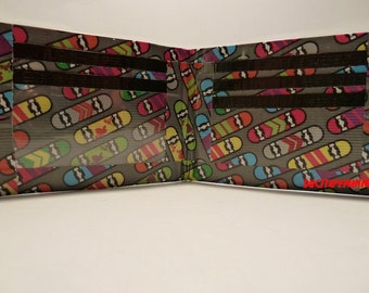 handmade duct tape wallet with multi color skateboards all over it