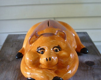 Brown Piggy Bank with Feet Crossed