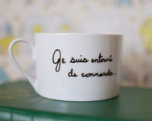 MATURE - Dainty White Teacup with Deceptively Rude French Writing