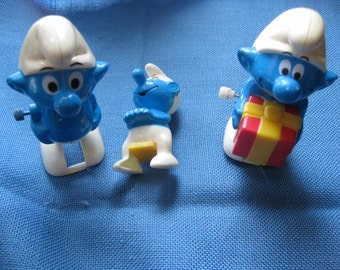 Two Vintage Smurf Wind Up Figurines and Extra Smurf Figure