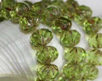 9 x 6mm . Czech Pressed Glass Crullers .  sparkling etched picasso peridot spring green crystal clear . 10 beads