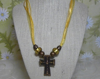 Necklace: Copper Cross Pendant with Golden Crystals on a Yellow Ribbon and Cord Necklace