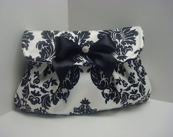 Satin black and white clutch