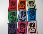 One initial canvas patch in any color you choose with any letter you choose....FREE SHIPPING USA