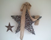 large wall star with burlap bow and benjamin moore covington blue paint