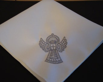 Napkins embroidered with a silver angel