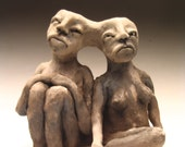 Twin; double, figure, form, nude, female, smoke fire, barrel fire, black, grey, circus, ceramic, clay, sculpture, hand built