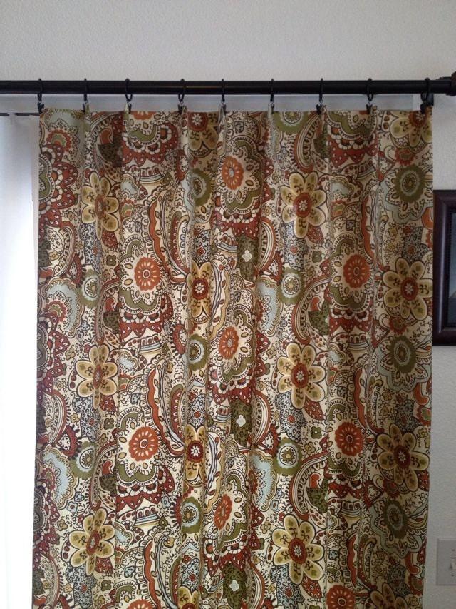 curtain panels in multi colored earth tone home decor fabric
