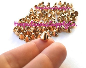 25pcs Acrylic Studs. Sew or Glue on. 8mm Cropped Cones. Choose: Gold, Silver, Brass,Gun Metal. FAST Shipping w/Tracking for Domestic Orders.