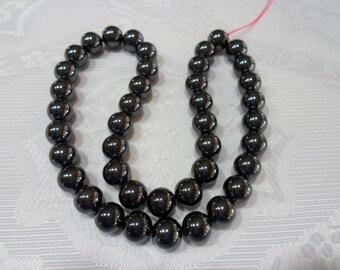 252 Perle hématite, non magnétique, 10 mm grade AAA 1 corde  environ 40 pièces