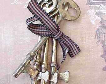 4 Nice Brass Colored Skeleton Style Keys