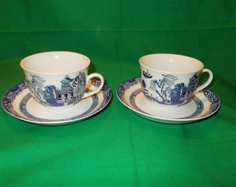 Two (2), Flat cups and Saucers, from Royal Oak, in the Blue Willow Pattern.
