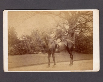 Cabinet Card of a Man Riding His Horse in a Park