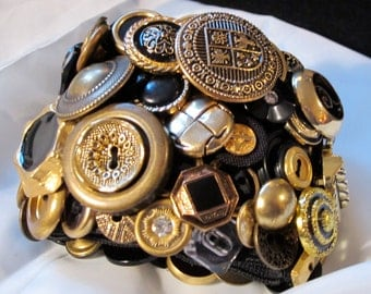 Vintage button bracelet, beautiful gold tone metals and vintage metal toned buttons.