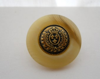 Metal and horn-look button with crown insignia center, medium size