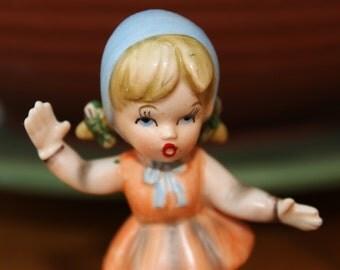 Vintage Statue of a Little Girl Roller Skating
