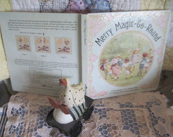 Merry Magic-Go-Round Changing Pictures Book  by Ernest Nister :)