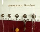 50s Freezer Door jewelry display by Recyclo Joe