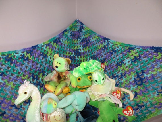 Crochet toy net hammock in variegated blues greens and