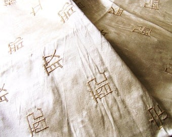 Golden silk with embroidered oriental characters