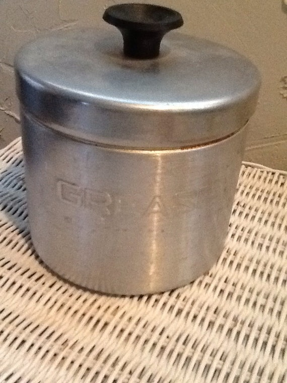 Aluminum vintage grease can with strainer for a retro kitchen