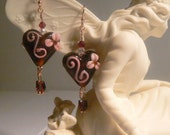 Heart Earrings set with Rose Gold and Garnet.