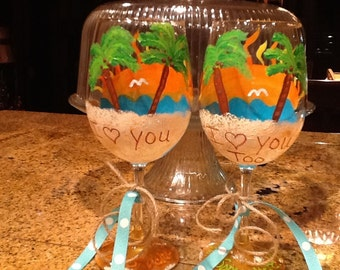 """Set of two summer beach wine glasses with """"I love you & I love you too"""" written in the sand."""