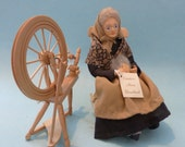 Quebec WOMAN CARDING WOOL by Mimi Bouchard with rocking chair & spinning wheel.