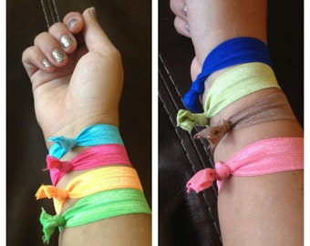 4 Colorful elastic hair ties..  MUST HAVE for SUMMER.. Pick your own color