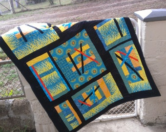 Funky abstract single bed quilt in aqua yellow black and orange
