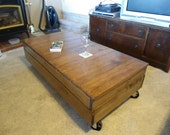 """24"""" x 40"""" factory cart coffee table in dark stain"""