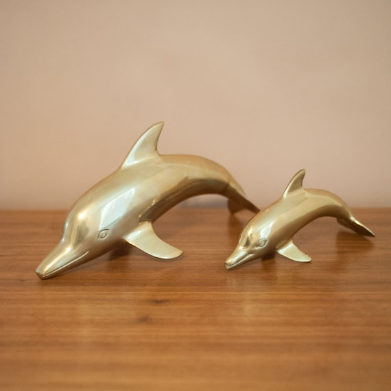 Vintage pair of large brass dolphins, Hollywood Regency, mid century modern, beach decor