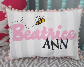 Baby pillow in light gray stripes with bumble bee accent. Personalized with name.