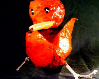 Red Bird.  Papier mache sculpture. Hand painted, designed and signed by the artist. Natural tree twig legs.