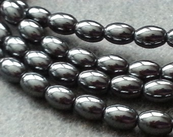 """1-16"""" Strand Hematite Smooth Rice Shaped 6mmx4mm (63 beads)"""