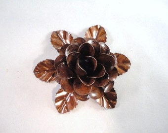 Medium Size Decorative Metal Hand Cut and Hand Painted Rustic Chocolate Burnt Brown Rose Mounted on a Bed of Metal Leaves.