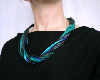 reclaimed bike necklace. wool and inner tube necklace.