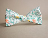 Green and White Bow Tie with Yellow and Orange Tulips