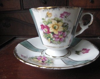 Large Japanese Footed Teacup and Saucer Yellow and Pink Flowers Gold Rimmed