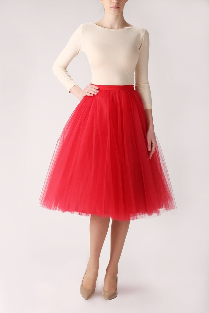 High-low hem tulle maxi skirt is attached to high-waisted spandex briefs with a comfortable, 1