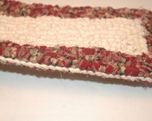 "Brownish red tones with cream center - locker hooked table runner   N4 - 4.5"" x 34"""